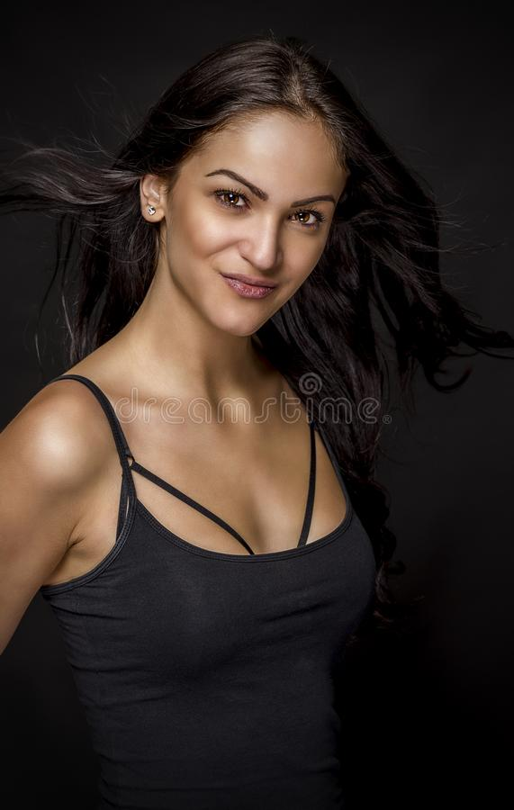 Portrait of beautiful female model on black background. stock photography