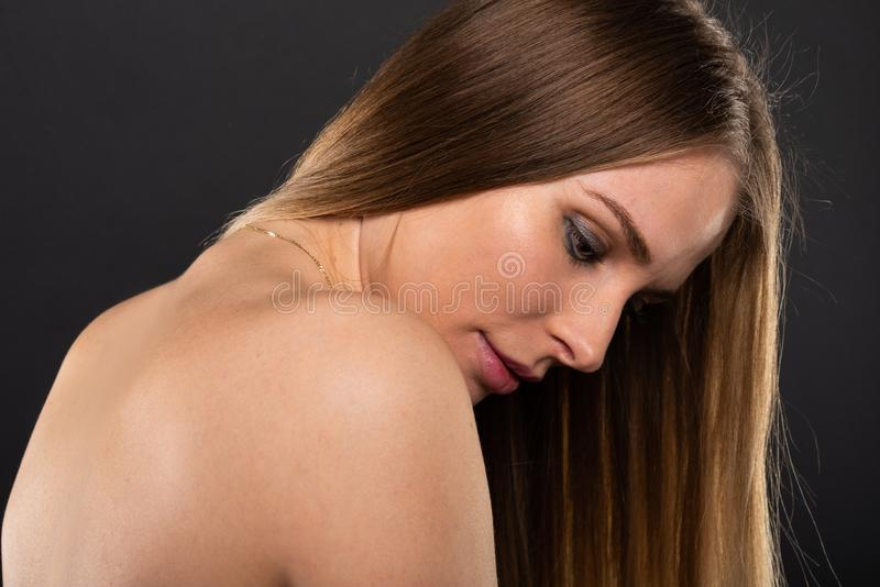 Portrait of beautiful female model with nude back royalty free stock photos