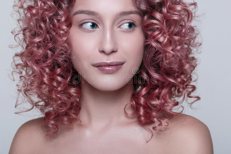 Portrait of beautiful female model with red curly hair royalty free stock photos