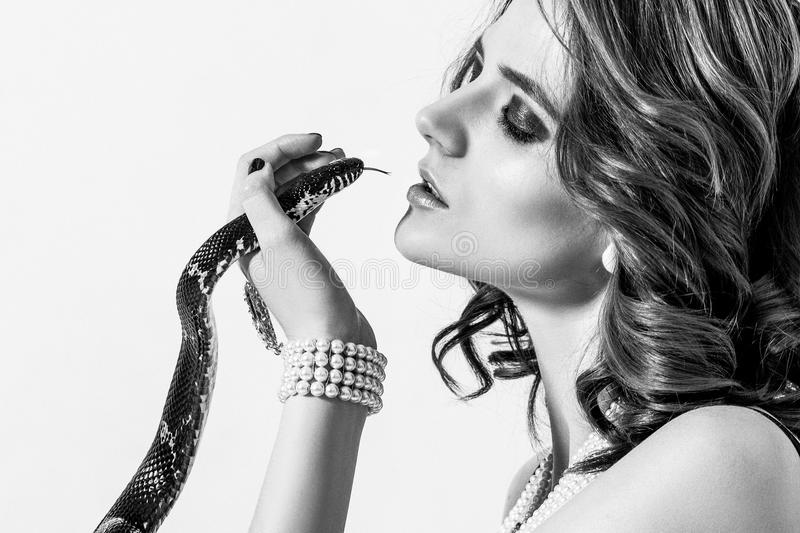 Portrait of a beautiful female model with a snake stock photography
