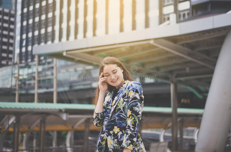 Portrait beautiful female with positive attitude expressing energy in good time,Woman walking in the city,Happy and smiling. Portrait beautiful female with royalty free stock image