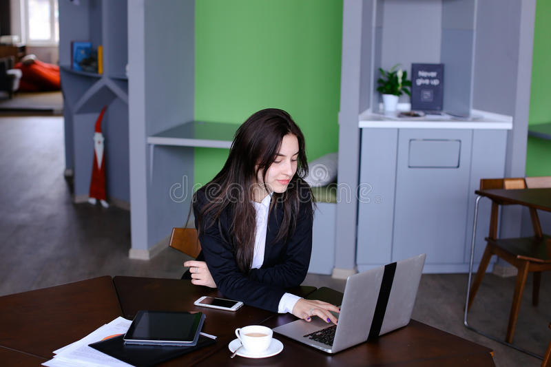 Portrait of beautiful female secretary who poses and looks away royalty free stock photo