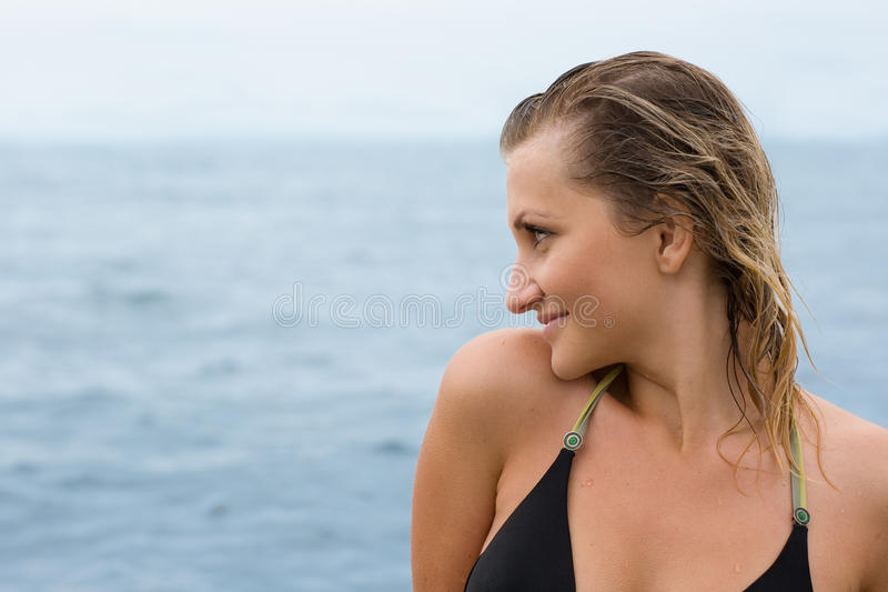 Portrait of a beautiful girl. Against the sea stock image