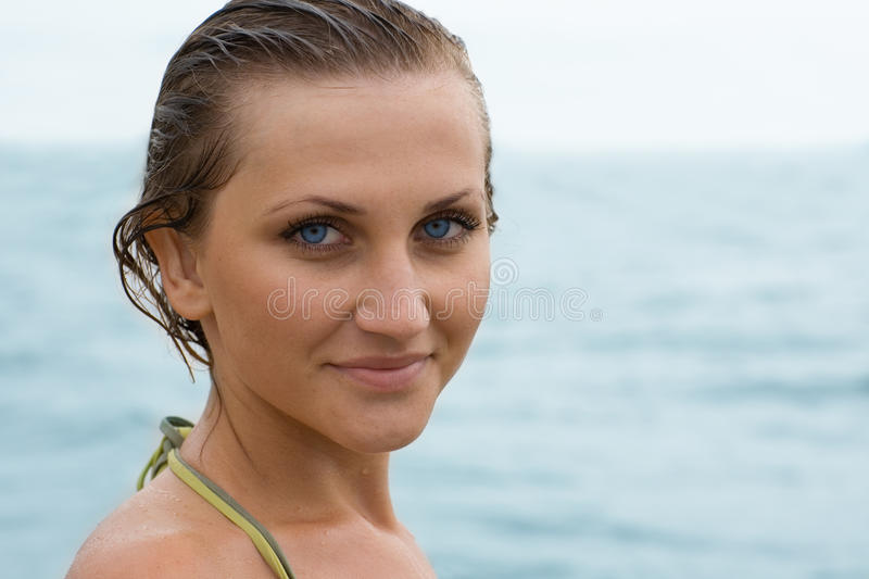Portrait of a beautiful girl. Against the sea stock photography