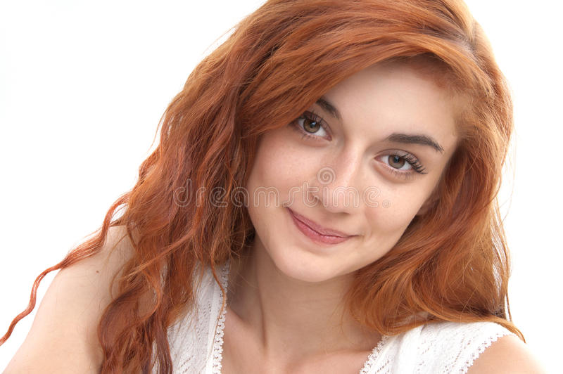 Portrait of beautiful girl. Portrait of a red haired girl of nineteen looking at the camera stock images