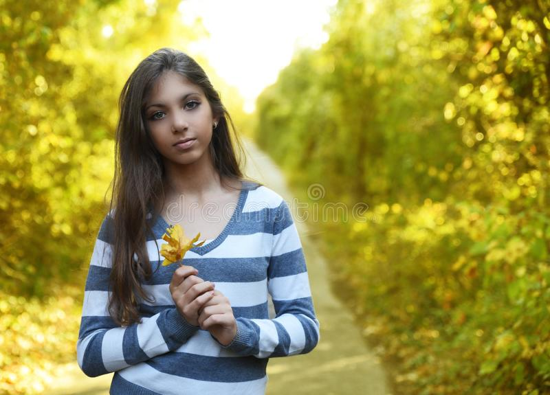 Portrait of beautiful girl with autumn forest backgroundgirl royalty free stock photos