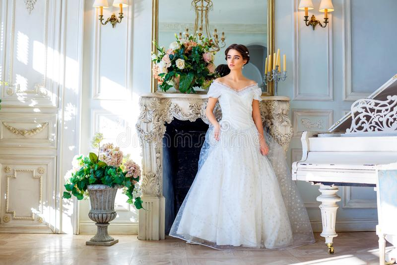 Portrait of a beautiful girl in a ball gown in the interior. Concept of tenderness and pure beauty in sweet princess look. Beautif royalty free stock photo