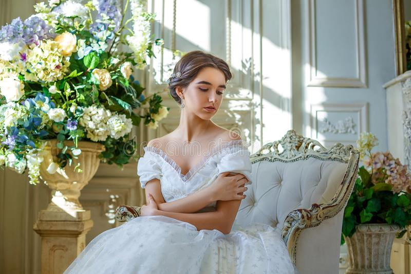 Portrait of a beautiful girl in a ball gown in the interior. Concept of tenderness and pure beauty in sweet princess look. Beautif. Ul girl in dress at romantic royalty free stock images