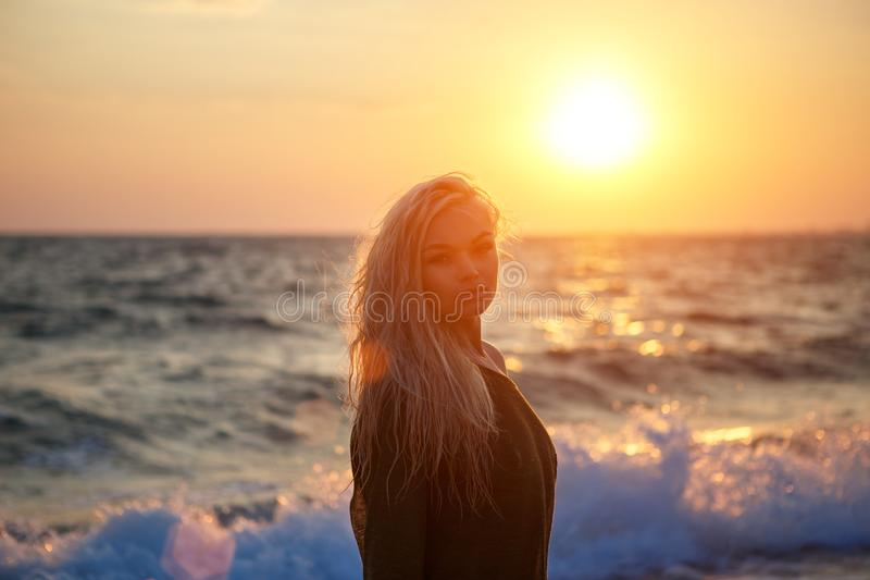 Portrait of a beautiful girl on the beach at sunset stock image