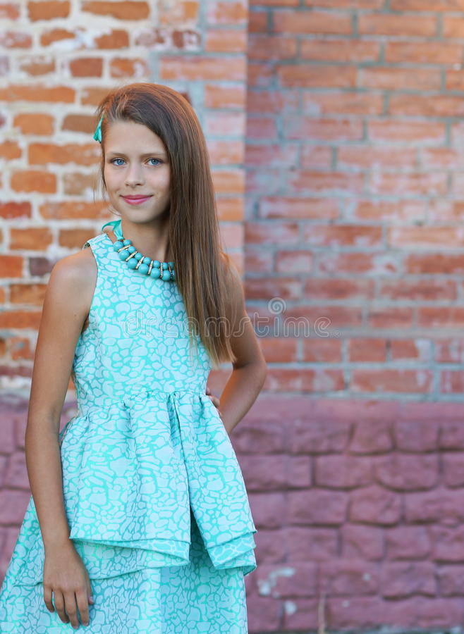 Portrait of a beautiful girl in a blue dress stock photography
