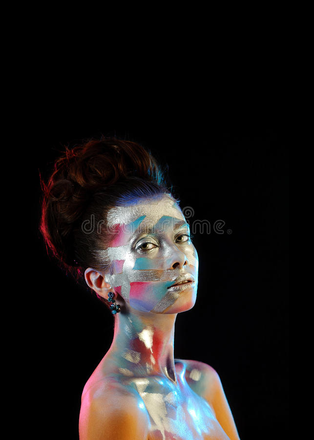 Portrait of beautiful girl with bright fashion art makeup stock photography