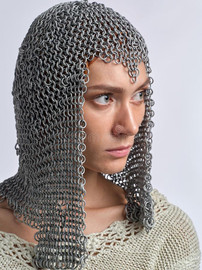 Portrait of a beautiful girl with a chain mail on her head stock photography
