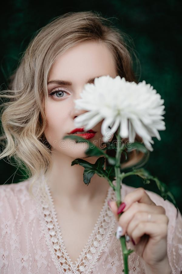 Girl with flower royalty free stock photography