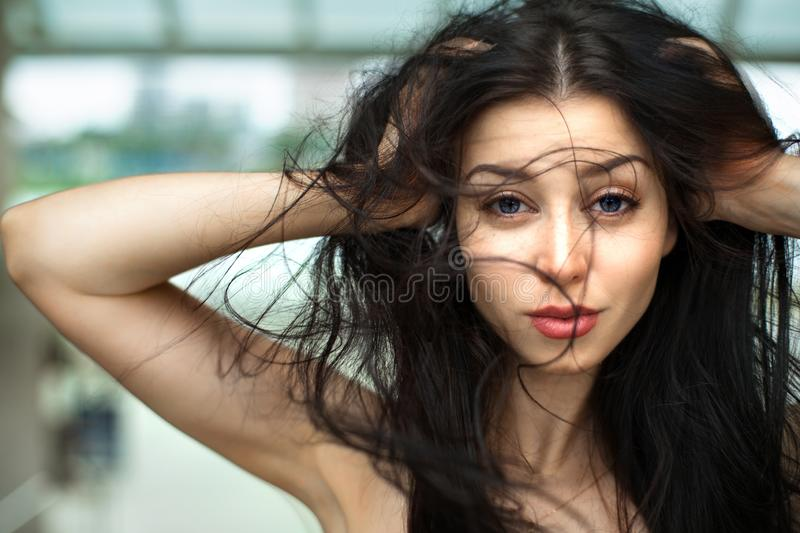 Portrait of the beautiful girl close-up, the wind fluttering hair. Natural beauty concept. royalty free stock image