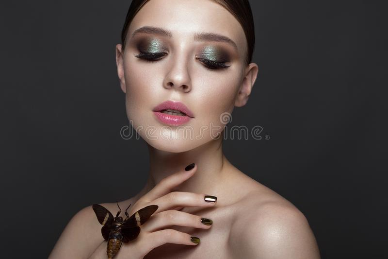 Portrait of beautiful girl with colorful make-up and cicada. Beauty face. Photo taken in the studio stock photos