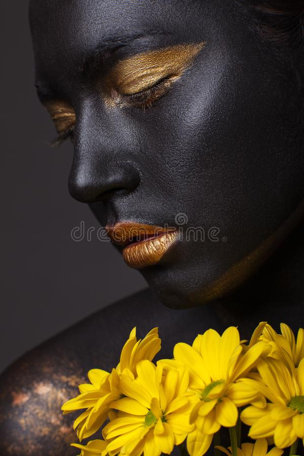 Portrait of a beautiful girl with a creative make-up, close-up. stock photo