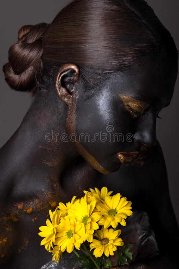 Portrait of a beautiful girl with a creative make-up. royalty free stock images