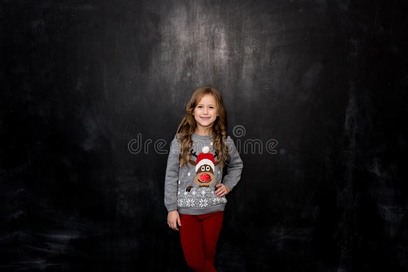 Portrait of a beautiful girl on a dark background royalty free stock photos