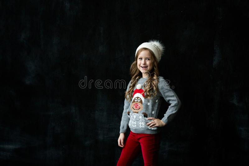 Portrait of a beautiful girl on a dark background royalty free stock images