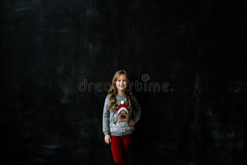 Portrait of a beautiful girl on a dark background royalty free stock photo