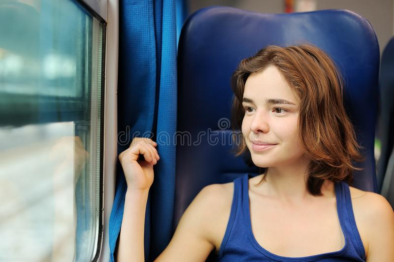 Portrait of a beautiful girl dreaming in a train car stock photo