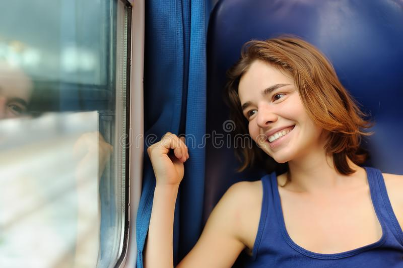 Portrait of a beautiful girl dreaming in a train car stock image