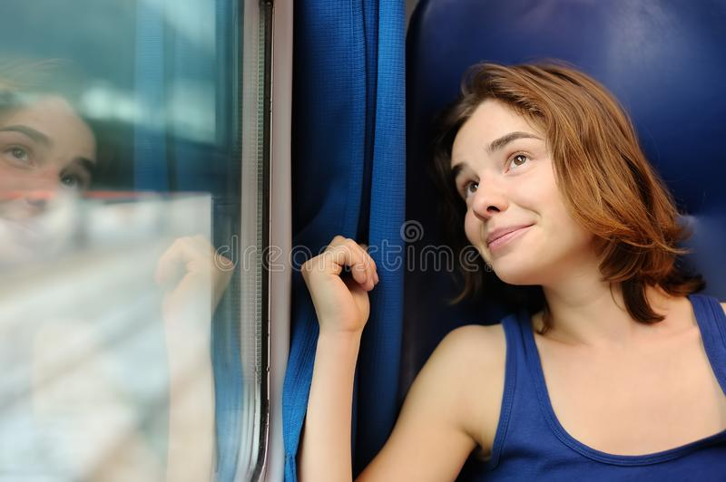 Portrait of a beautiful girl dreaming in a train car stock images