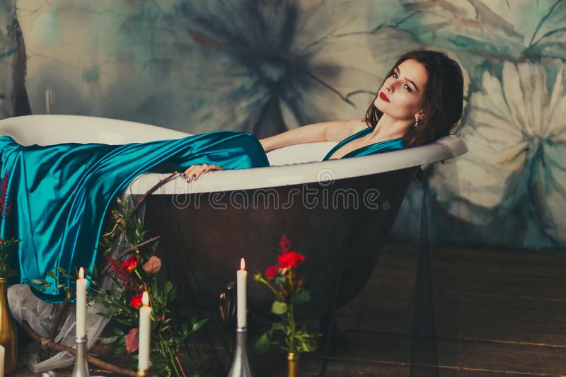 Beautiful girl in a dress in the bath royalty free stock photos