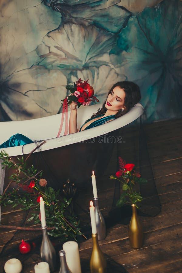 Beautiful girl in a dress in the bath stock photos
