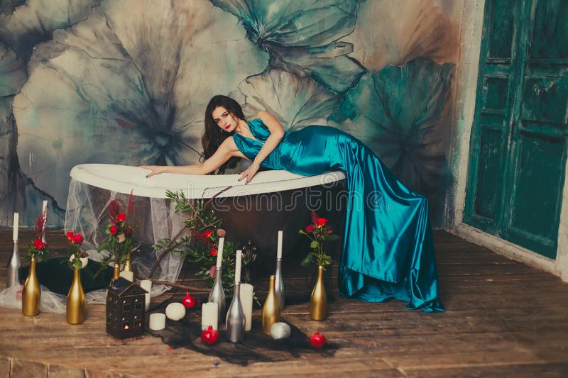 Beautiful girl in a dress in the bath stock photography