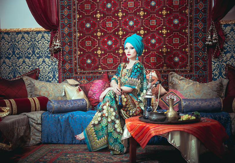 Portrait of a beautiful girl in eastern dress and jewelry stock images