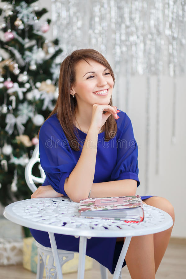 Portrait of a beautiful girl in elegant Christmas decorations. Portrait of a beautiful young girl in elegant Christmas decorations royalty free stock photography