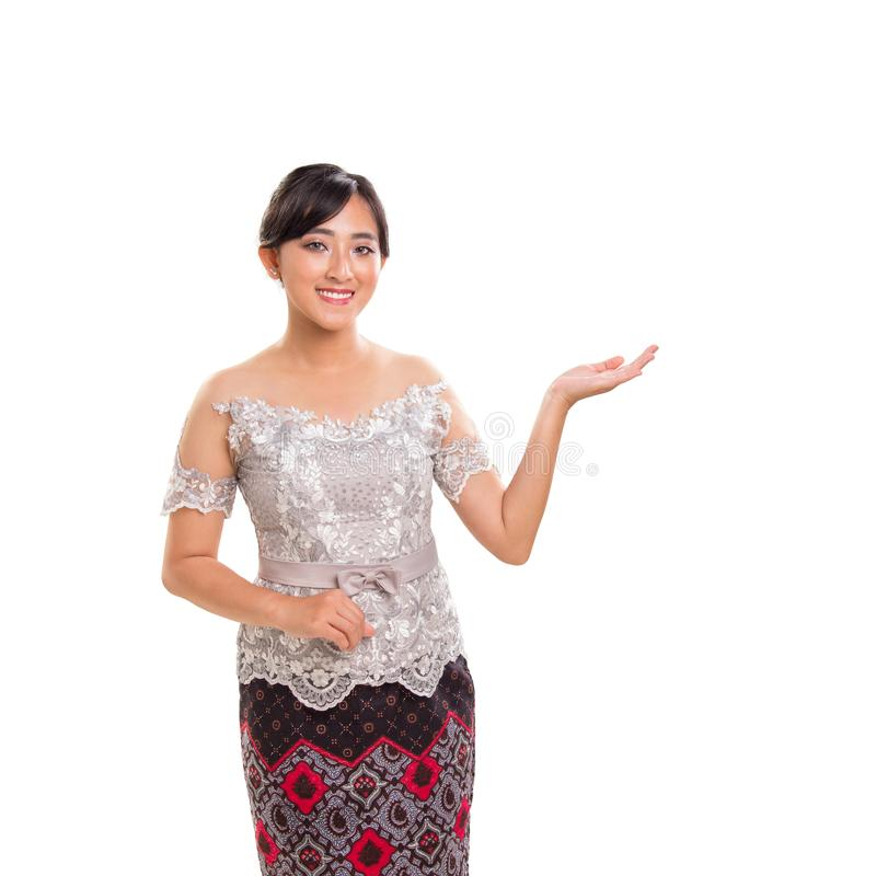 Portrait of beautiful girl in ethnic clothes gesturing suggestion, isolated on white background stock image