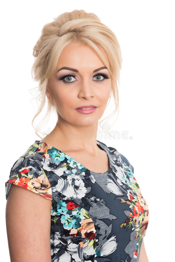 Portrait of a beautiful girl in a flowered dress stock photo