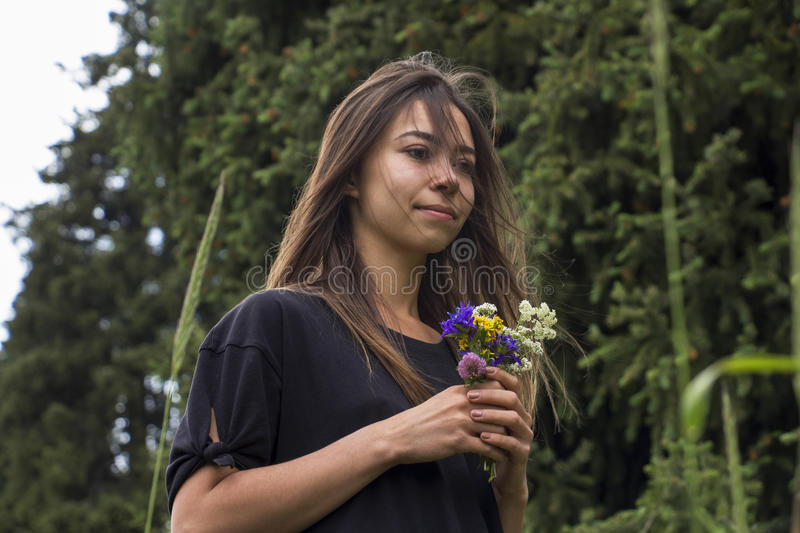Portrait of beautiful girl with flowers stock image