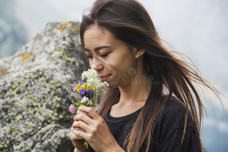 Portrait of beautiful girl with flowers royalty free stock photography
