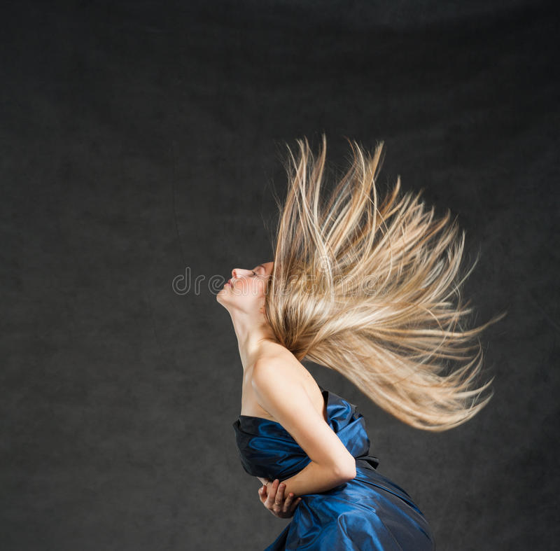 Portrait of a beautiful girl with flying blond stock images