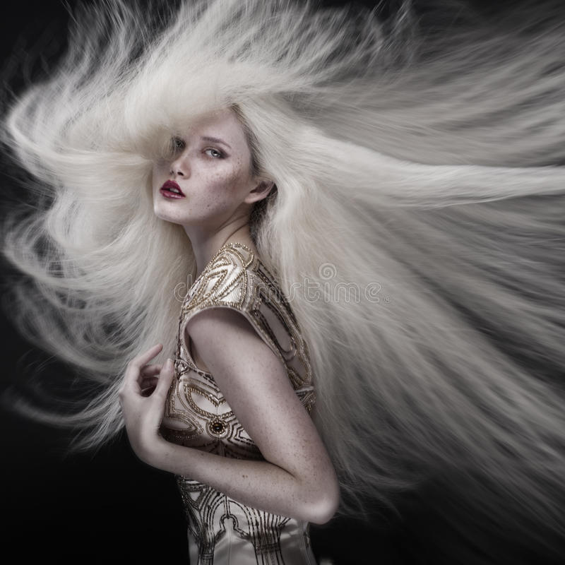 Portrait of girl with flying hair stock images