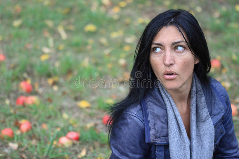 Portrait of a beautiful girl in forest apples stock images