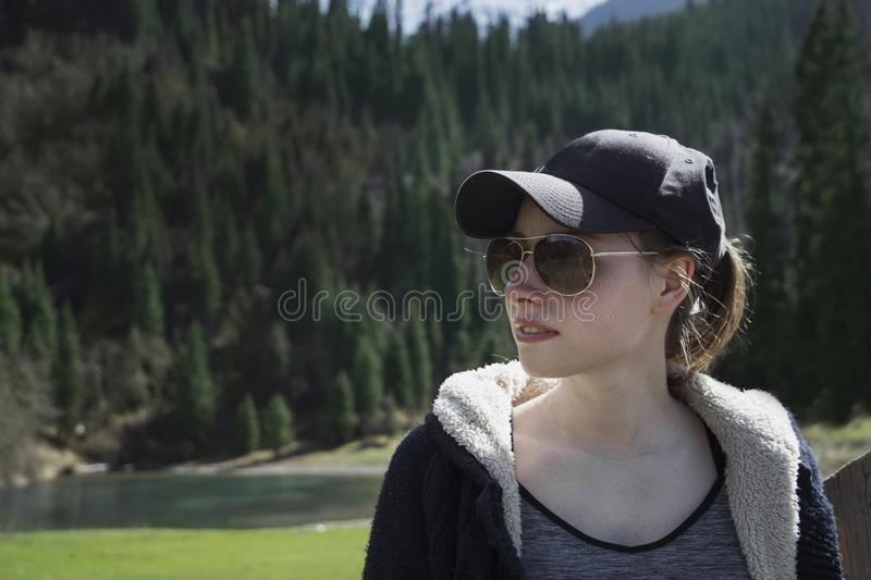 Portrait of a beautiful girl in glasses stock photo