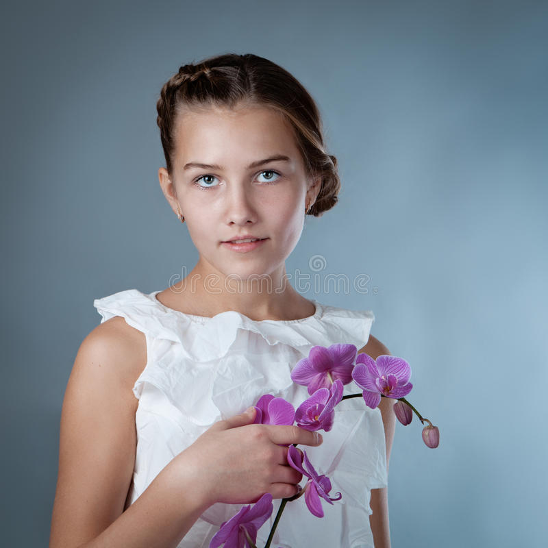Download Portrait Of Beautiful Girl On Gray Background Stock Photo - Image: 35261560