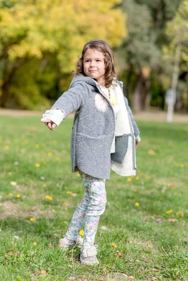 Portrait of beautiful girl. Portrait of beautiful and happy little girl outdoor royalty free stock image