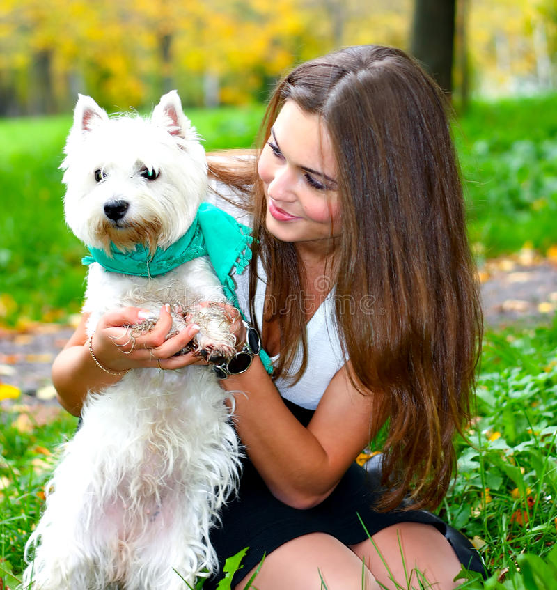 Portrait of beautiful girl with her dog stock images