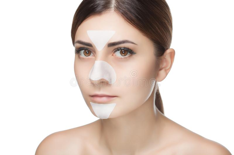 Portrait of a beautiful girl with a mask from acne on the nose and t-zone.  royalty free stock image