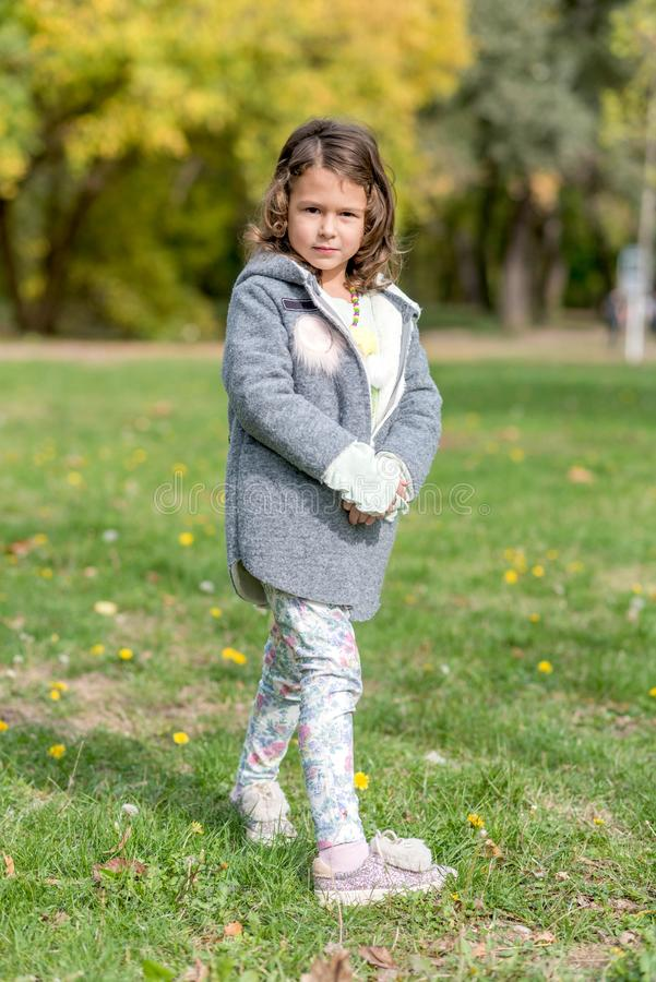 Portrait of beautiful girl. Outdoor with Autumn background stock photo