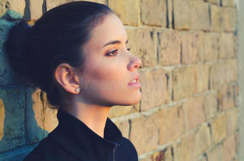 Portrait of the beautiful girl outdoor watching spring sunrise stock photo