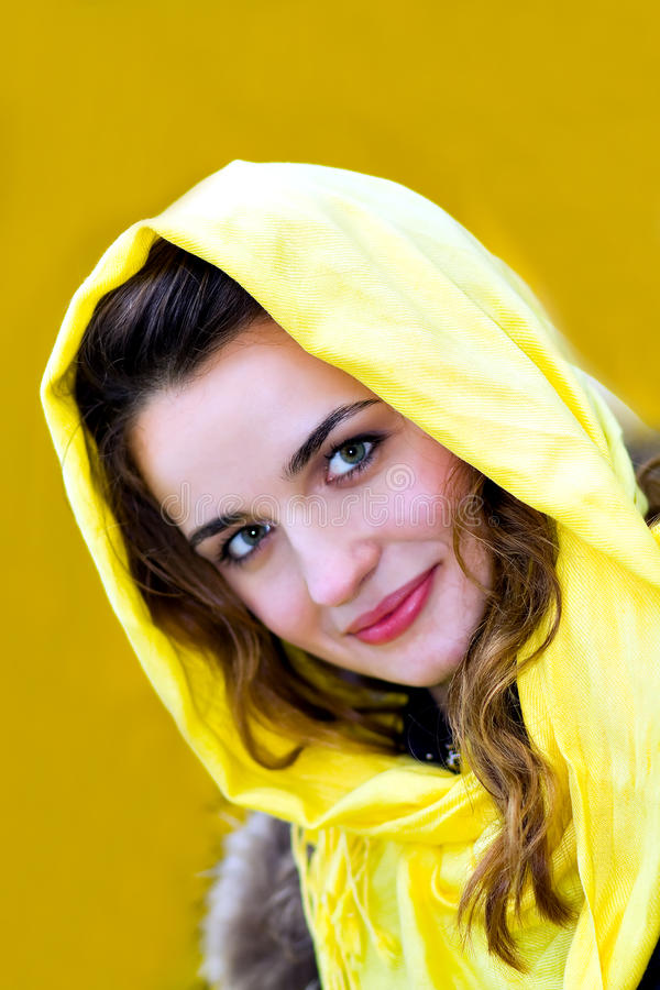 Portrait of the beautiful girl over yellow stock photos