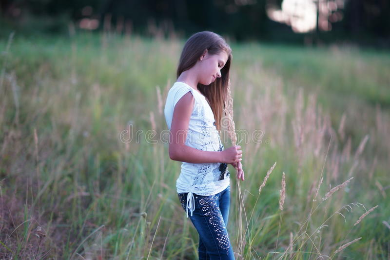 Portrait of a beautiful girl posing outdoors. On the Sunset stock image