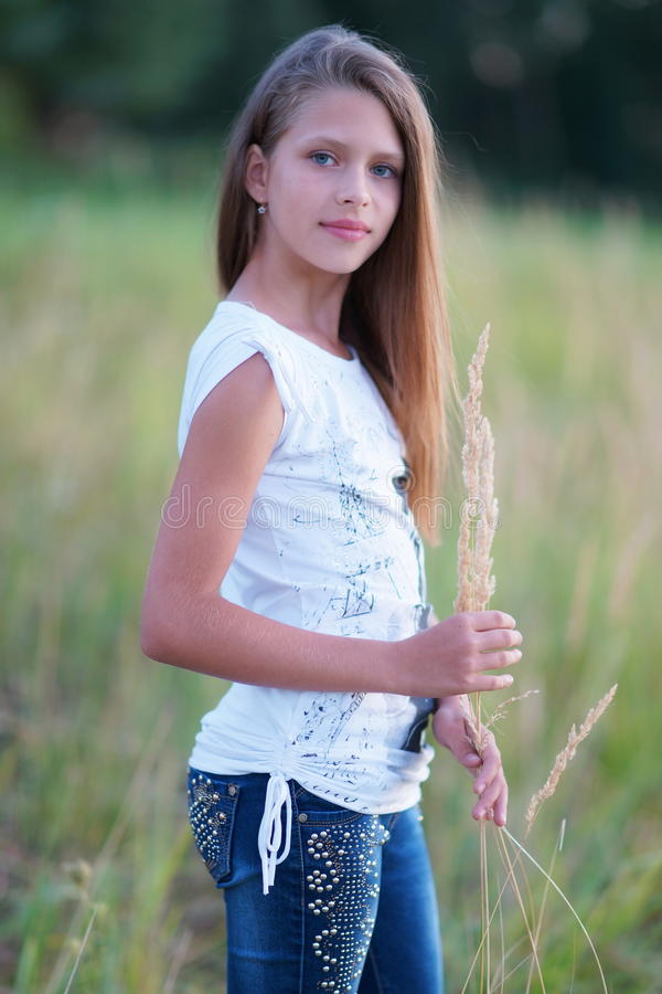 Portrait of a beautiful girl posing outdoors. On the Sunset royalty free stock photo