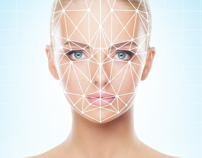 Portrait of beautiful girl with a scnanning grid on her face. Woman with face id scanner. Biometric verification. Security, facial recognition, future royalty free stock photo